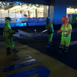 Avon crew members lay out stencil