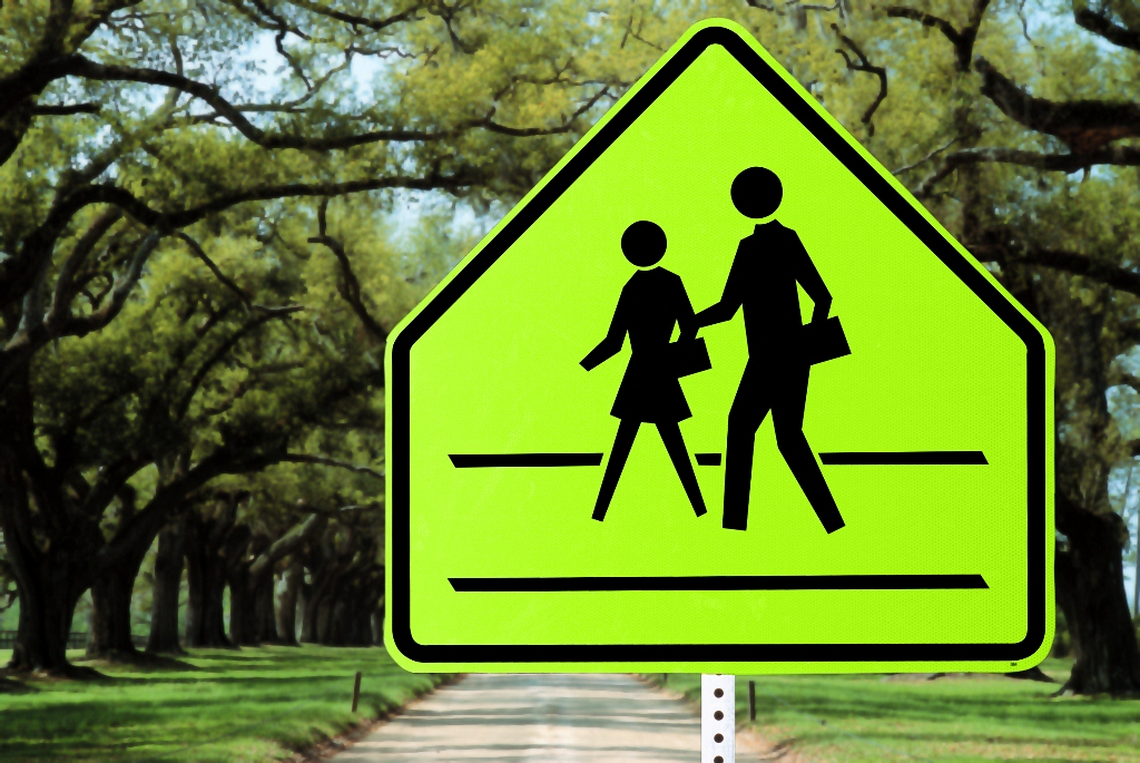Image of information sign indicating a cross walk.
