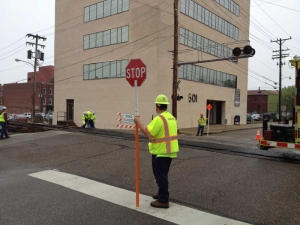 RoadSafe crew flagging at railroad crossing